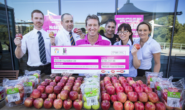 Iga retailers present donation to glenn mcgrath co founder   president m...